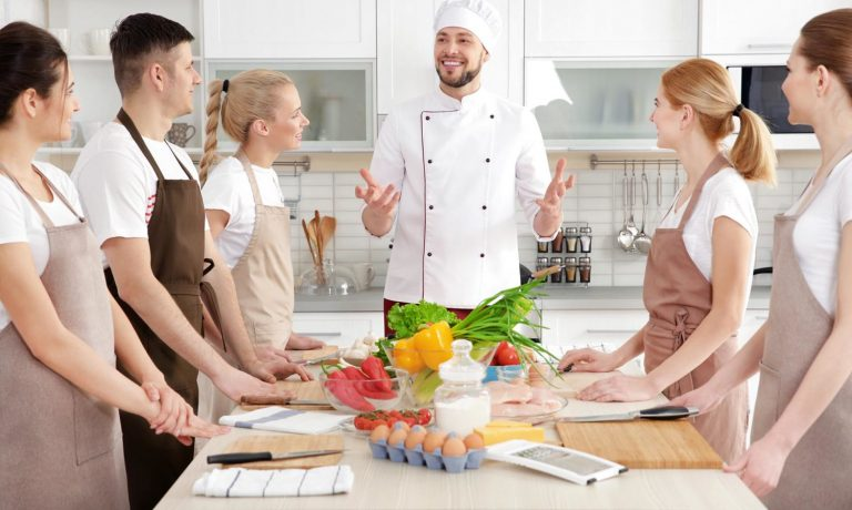 Male chef and group of people at cooking classes; Shutterstock ID 633405473; Purchase Order: -